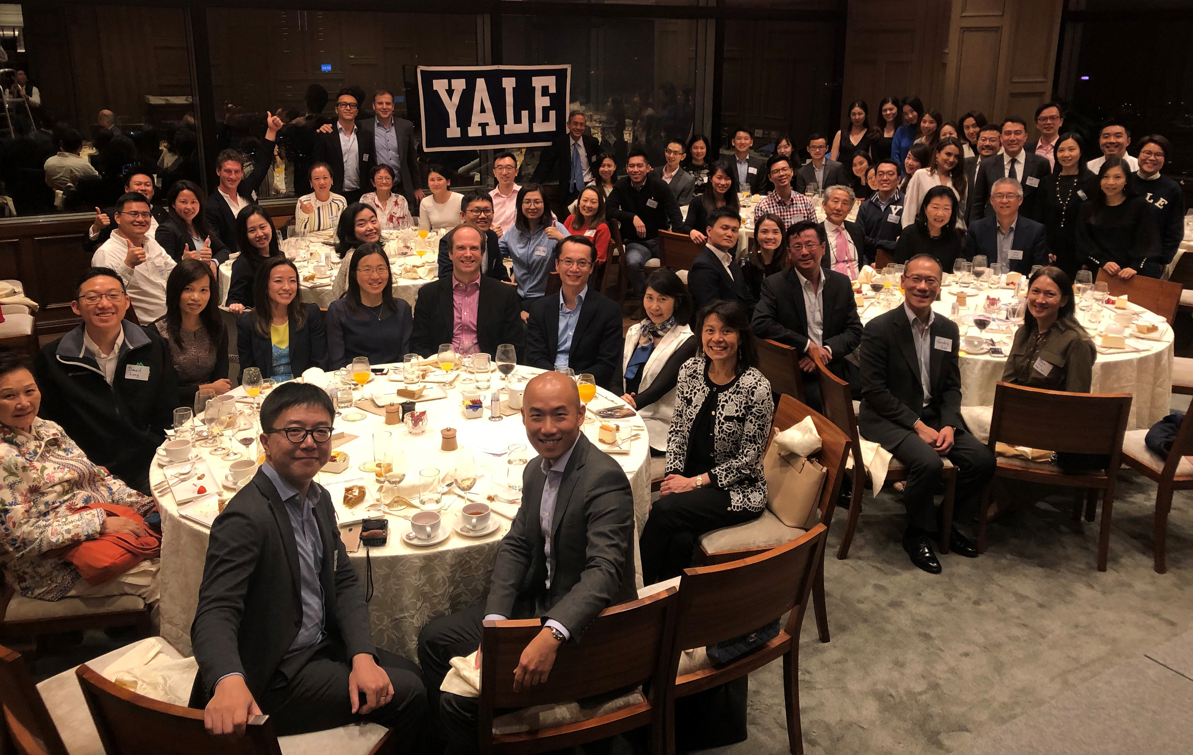 Alumni gather during Thanksgiving dinner with the Yale Club of Hong Kong.