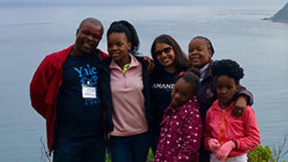 Monisha Merchant '04 M.B.A. with Taona Tsopo, program manager for Amandla Development, and his family.