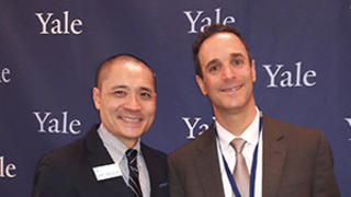 Glen Gechlik '05 M.B.A. (right) receiving a Yale Leadership Award from the Yale Alumni Association with Henry Kwan '05 M.A. (left) director for Shared Interest Groups at YAA.