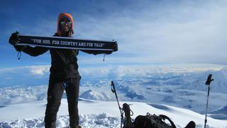 Abby Gahm '17 raises the Yale flag at the top of Denali.