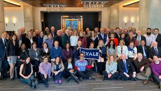 Current and former members of the YAA Board of Governors gather in New York City in February 2019.
