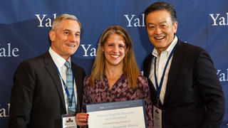 YANA Vice President Lou Martarano '81 MBA, Executive Director Rachel Litman '91, and Chair Ken Inadomi '76 accept an Excellence Award during the 2018 YAA Assembly and Yale Alumni Fund Convocation.