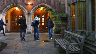 Students gather outside one of Yale's residential colleges.
