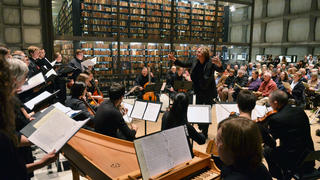 Orchestra and mistro in a room