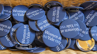 A collection of 50WomenATYale150 buttons