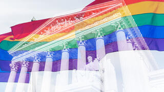 Image of LGBTQ+ flags double exposed over the Supreme Court of the United States