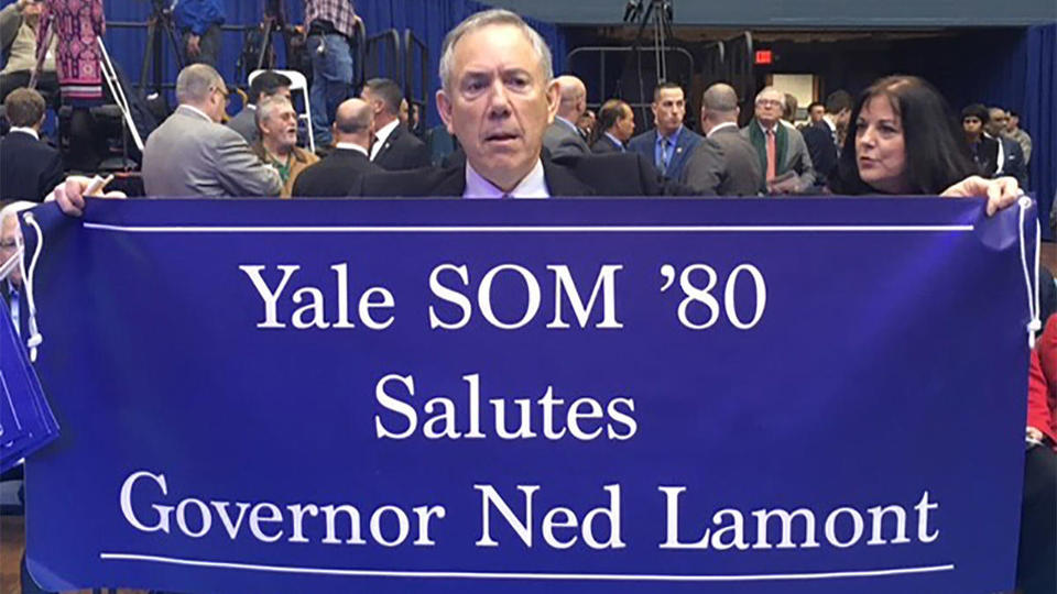 A Yale alumnus celebrates Ned Lamont's inauguration as the new governor of Connecticut.