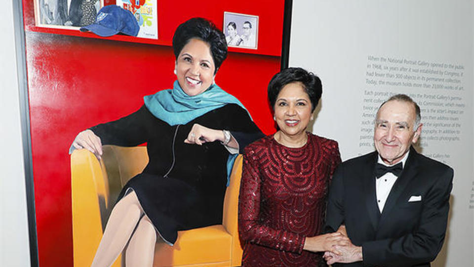Indra Nooyi '80 MBA poses with her portrait and artist Jon R. Friedman at the 2019 American Portrait Gala on November 17.