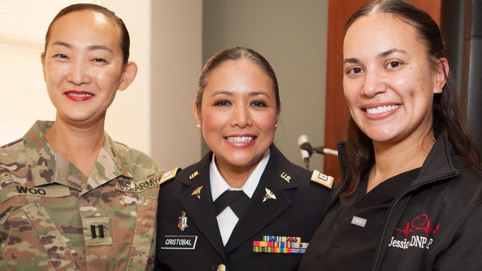 (L to R) Capt. Eunice Woo, Capt. Lydia Cristobal '16 DNP and Jessica Ramos connect after the veterans recognition ceremony. Photo: Thomas Simpson