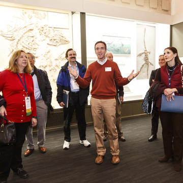 Alumni touring a lab while visiting campus