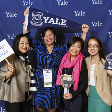 Alumni posing at the Yale photobooth