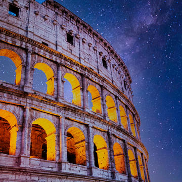 Colosseum at Night with Stars in Rome, Italy.