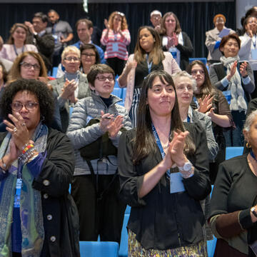 Attendees applaud at the end of the 2019 Impact Conference.